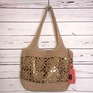 The sak crocheted straw hobo bag
